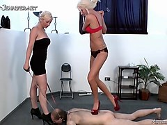two blonde femdom mistresses stomp the hell out of a guy