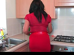 Danica collins in the kitchen with a cucumber